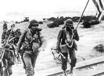 1ere div d infanterie us porend pied sur la plage de saint leu